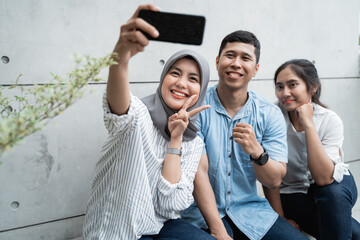 selfie group of friends when hang out using smartphone camera