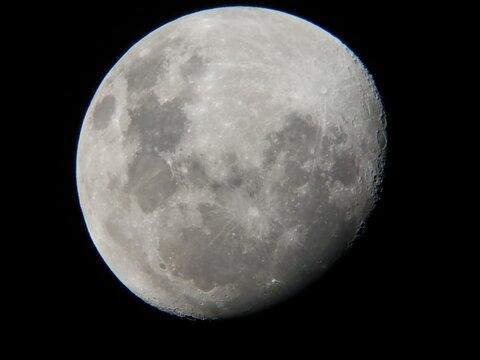 moon viewed through an amateur astronomer telescope