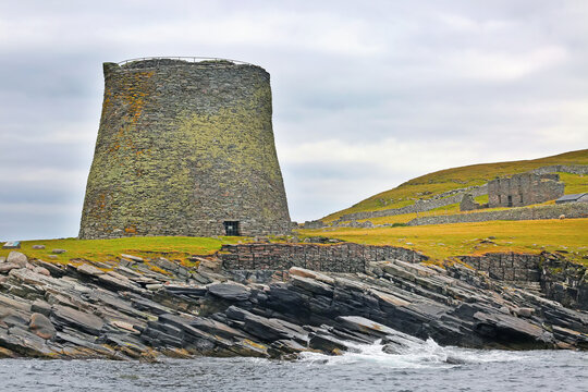 Broch of Mousa;  which is a preserved Iron Age round tower on the rocky coastline. It is on the island of Mousa in Shetland, Scotland.