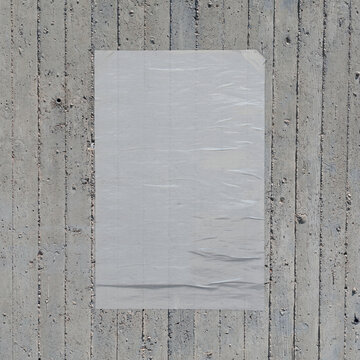 white crumpled poster on concrete wall background