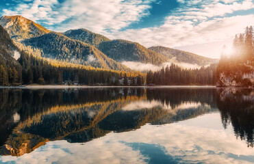Fotomurales - Amazing View on Braies Lake during sunrise. Fantastic misty morning. Mountains under sunlit reflected in water. Fantastic nature Landscape on Lago di Braies. Best Popular places for Photographers.