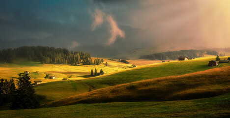 Fotomurales - Fantastic Evening Scene. Dramatic Picturesque clouds glowing sunlight, over the Alpe di Siusi valley during sunset. Amazing Nature Landscape. Awesome natural Background. Incredible colorful Scenery