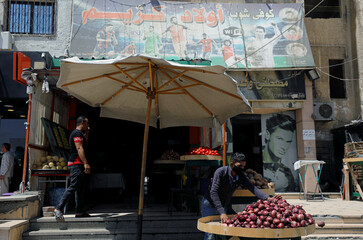 A banner with pictures of the English football club Liverpool player Mohamed Salah, Barcelona's Lionel Messi and Cristiano Ronaldo of the Italian club Juventus,is seen above a cafe in Cairo