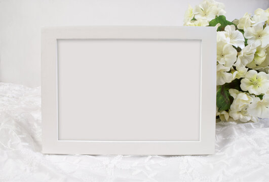5x7 White Frame Mockup with Flowers