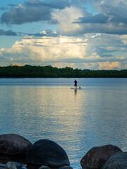 Paddleboarder on calm lake