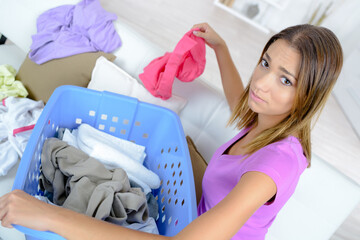 unhappy woman housewife is engaged in the laundry