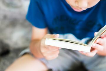 Closeup Child Reading Book