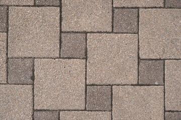 Stone pavement in perspective. Stone pavement texture. Granite cobblestoned pavement background. Gray brick stone background