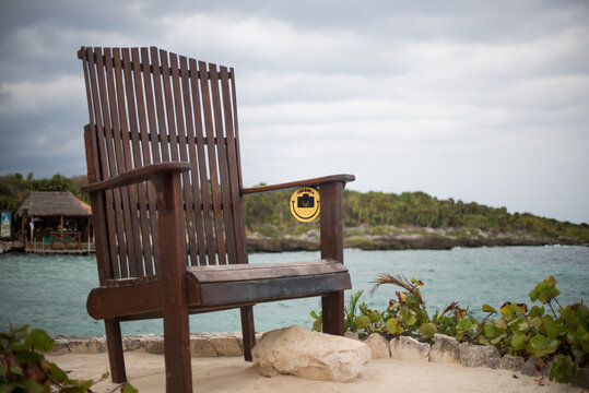 wooden chair on the beach