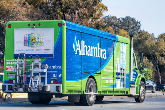 May 28, 2020 Redwood City / CA / USA - Close up of Alhambra water delivery service truck driving on a street