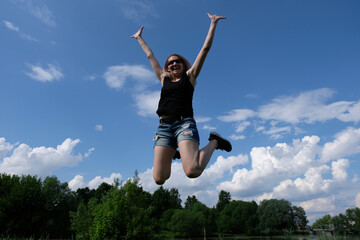 Happy girl. Jumping up to the sky.