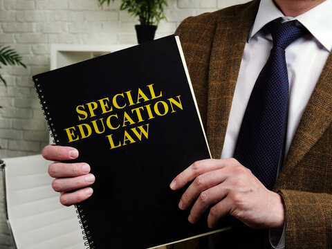 Man in suit holds Special Education Law.