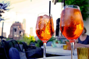Fototapeten Alkohol Cocktail glasses set on table, bar terrace