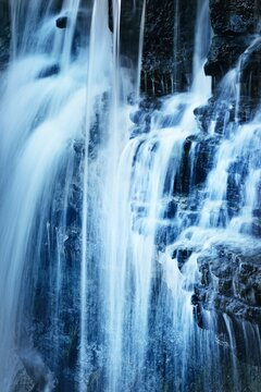Jagala waterfall texture, Estonia. Close-up, long exposure. Blue and white water splashes. Abstract natural pattern. Environmental conservation, travel destinations, graphic resources