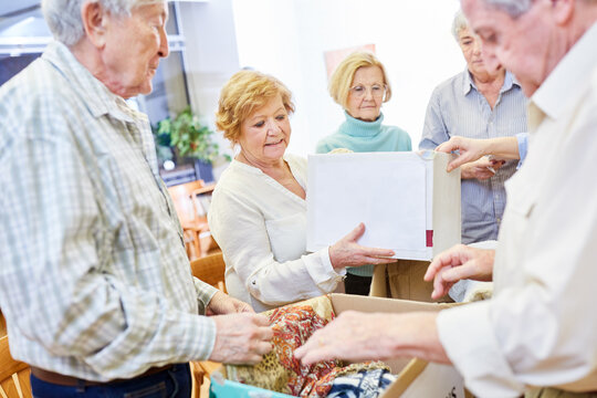 Voluntary seniors donating clothes