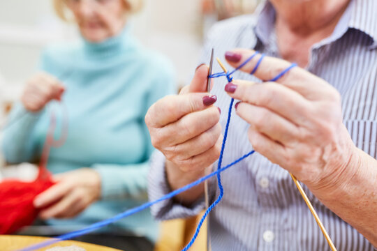 Seniors learn to crochet in a knitting club