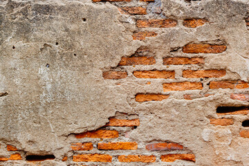 Weathered old ruin concrete wall reveal brick cracked inside grunge aged building texture for background.