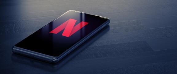 KYIV, UKRAINE-JANUARY, 2020: Netflix on Smartphone Screen. A Smart Phone Lying on a Dark Surface with a Netflix Application. Social Media Concept