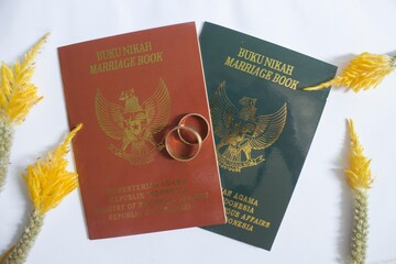 Indonesia marriage book with couple ring, selective focus