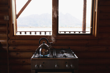 A kettle is heating on gas with a view