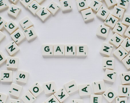 GAME word made from Scrabble game letters on white background, May 14, 2018 in Vilnius Lithuania.