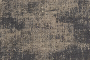 Rustic background with canvas texture with with spots of gray paint