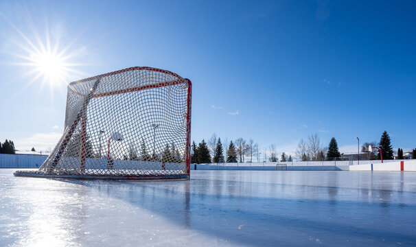 Hockey net on clear sunny winter day with sunburst on fresh ice