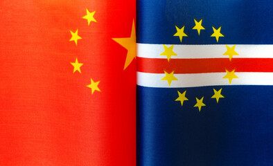Fototapeten Rot fragments of the national flags of China and the Republic of Cape Verde close-up