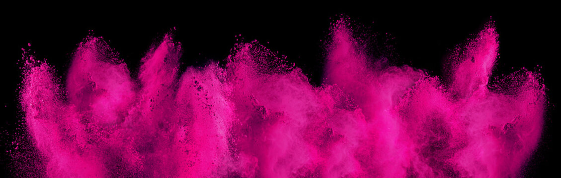 pink magenta holi paint color powder explosion isolated  dark black background. industry beautiful party festival concept