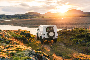 4x4 Truck looks out over sunrise landscape in Iceland