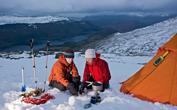 couple reading map on the side of Helvellyn mountain