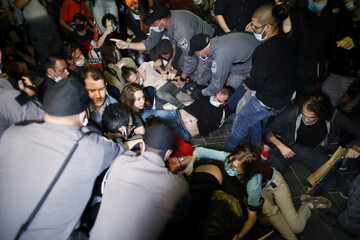 People take part in a demonstration against the aggression of Israeli forces against Palestinians, domestic violence, as well, to show solidarity with the Black Lives Matter movement, in Jerusalem