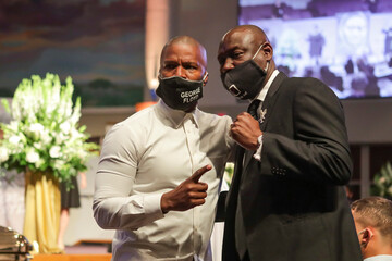 Civil rights attorney Ben Crump poses for a picture with actor Jamie Foxx after the funeral for George Floyd at The Fountain of Praise church in Houston