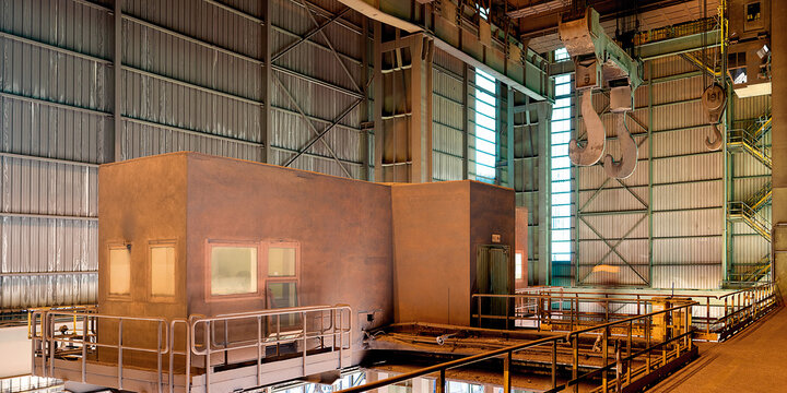 Interior of spacious workshop with large metal walls and construction inside of industrial factory in Asturias