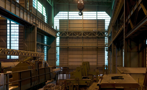 Interior of spacious industrial workshop with various metal elements and constructions in industrial building of modern factory in Asturias