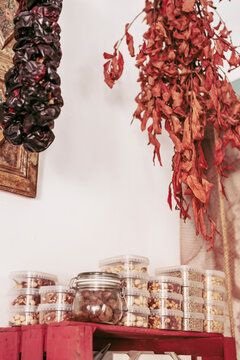 From below pieces of delicious dried meat hanging on ropes from ceiling in cozy local food store
