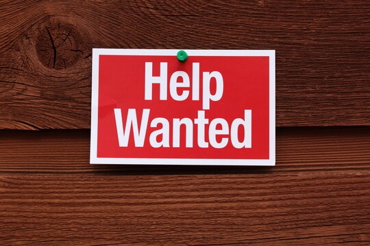 Help Wanted Sign on Wood Background
