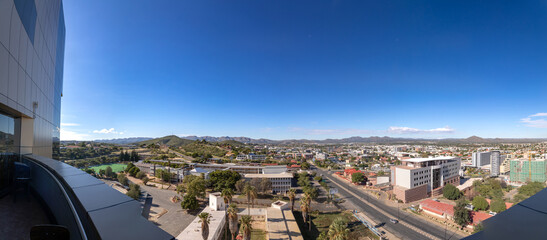 Skyline of Namibia's capital Windhoek with a cloudy sky