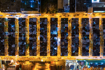 Wall Mural - Aerial view from top. Old apartment in Kowloon, Hong Kong at night, buidings exterior
