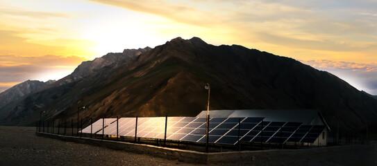 Solar panels farm on beautiful landscape.