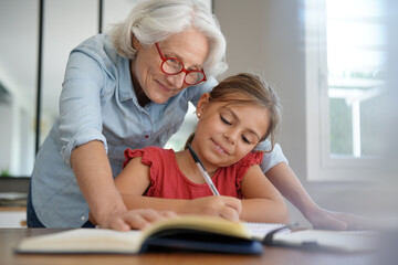 grandmother helping grandkid with homework