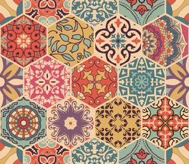 Seamless colorful patchwork tile with Islam, Arabic, Indian, Ottoman motifs. Majolica pottery tile. Portuguese and Spain decor. Azulejo. Ceramic tile in talavera style. Boho pattern
