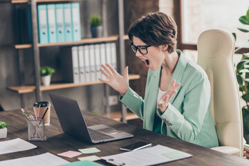 Angry frustrated depressed secretary girl agent marketer sit desk chair work laptop missed deadline start up progress development report scream wear blazer in workplace workstation