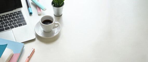 The top view copy space of the white working desk is surrounding by a coffee cup and office equipment. Fotomurales