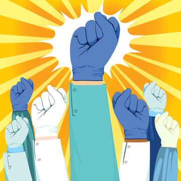 Beautiful young female nurse winking and raising fist up power concept