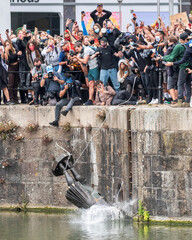 The statue of Edward Colston falls into the water after protesters pulled it down in Bristol