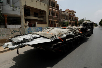 A truck loaded with the wreckage of the crashed Pakistan International Airlines' PK8303 plane, is pictured after it was retrieved from the roof of a house at the crash site, in Karachi,