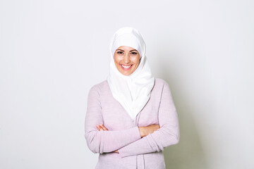 Portrait of pretty young arab muslim woman in head scarf smile. Portrait closeup of muslim woman 20s in hijab smiling isolated over white background.