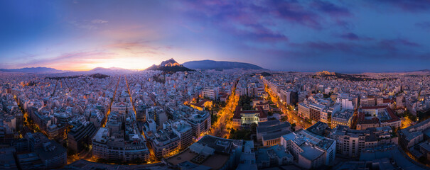 Wide mystical sunrise panorama of Athens, Greece. Horisontal panoramic view of Athens city center