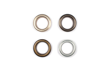 Four brass multicoloured metal eyelets or rivets - curtains rings for fastening fabric to the cornice, isolated on white. With copyspace for text for your presentation Wall mural